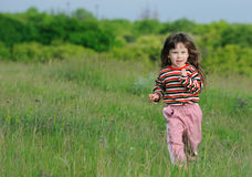 The running girl on a green field Stock Photography