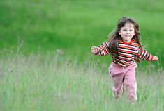The running girl on a green field Royalty Free Stock Photo
