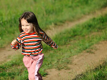 The running girl on a green field Royalty Free Stock Image
