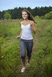 Running girl on green grass stock photography