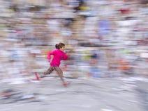Running girl panning. Istanbul, Turkey - December 28, 2014: A girl running in the street panning shots views Stock Photos