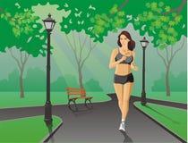 Running girl. Girl in the park. Morning jogging Stock Photo