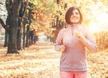 Running girl portrait in atumn park Stock Image