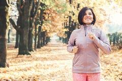 Running girl portrait in atumn park Royalty Free Stock Photos