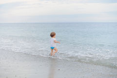 Running Girl in Sea Stock Images