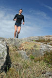 Running girl in shorts outdoor. Running young woman in shorts outdoor Royalty Free Stock Photos