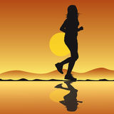 Running girl silhouette with sunset Royalty Free Stock Photos