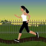 Running girl in sportswear on a background of forest landscape or in the park at sunset. In the background are trees, bi Royalty Free Stock Image