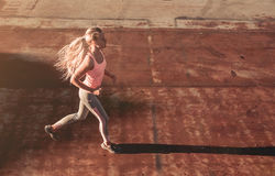 Running girl on street Royalty Free Stock Images