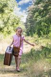 Running girl with suitcase Royalty Free Stock Photos