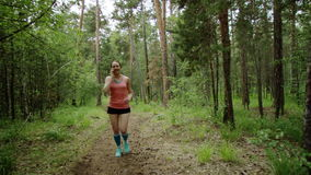 Running girl talks on the phone stock video footage