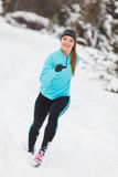 Running girl wearing sportswear, winter fitness Stock Photography