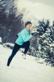 Running girl wearing sportswear, winter fitness Stock Photo