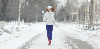 Running girl in winter sweater Royalty Free Stock Images
