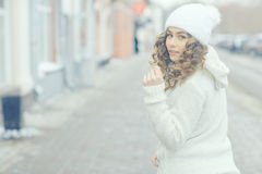 running girl in winter sweater Stock Photography