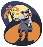 Running girl in witch costume Stock Images