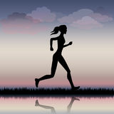 Running girl. Woman running on the road in the morning Royalty Free Stock Photo