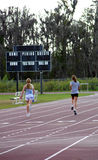 Running Girls. Two girls running track at school Stock Photos