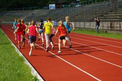 Running girls and photographer Stock Photography