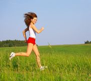 Running on the grass Stock Photo
