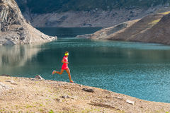 Running in the great outdoors mountain among the alpine lakes Royalty Free Stock Images
