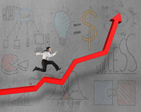 Running on growing red arrow with business doodles Stock Image