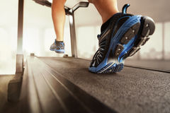 Running in a gym on treadmill royalty free stock photography