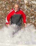 running hög snow Royaltyfria Bilder