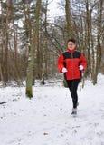 running hög snowkvinna Arkivbilder