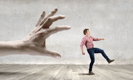 Running from hand Royalty Free Stock Photo