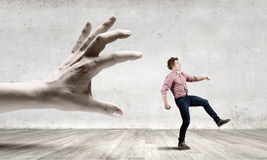 Running from hand Royalty Free Stock Image