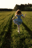 Running. Happily running through the field stock images