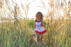 Running Happy little girl Stock Photo