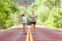 Running Health and fitness - runners jogging. Running Health and fitness. Runners on run training during fitness workout outside on road. People jogging together stock image