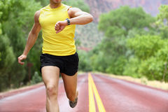 Running with heart rate monitor sports watch royalty free stock image