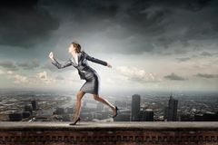 Running in a hurry Stock Images