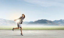 Running in a hurry Royalty Free Stock Image