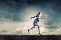 Running in a hurry Royalty Free Stock Photo