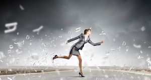 Running in a hurry Stock Image