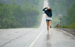 Running In The Rain Royalty Free Stock Images