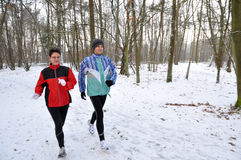 Running In The Snow, Sharp On Men Royalty Free Stock Photos