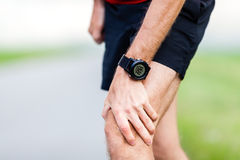Running injury, knee pain Royalty Free Stock Photos