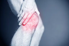 Running injury, knee pain Stock Photos