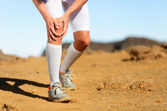 Running injury - Male runner with knee pain Royalty Free Stock Photos