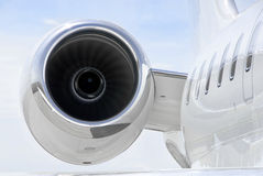 Running Jet Engine on luxury private jet aircraft - Bombardier. Running Jet Engine closeup on a luxury private jet aircraft - Bombardier Global Express royalty free stock photography