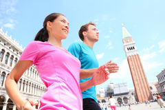 Running jogging couple in Venice Royalty Free Stock Photo