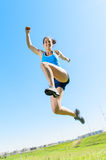 Running and jumping. Beautiful sport woman runing and jumping cheerful Royalty Free Stock Image