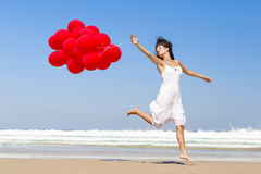 Running and Jumping with ballons Royalty Free Stock Photos