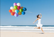 Running and Jumping with ballons Stock Images