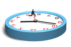 Running and jumping over second hand on clock Royalty Free Stock Photo